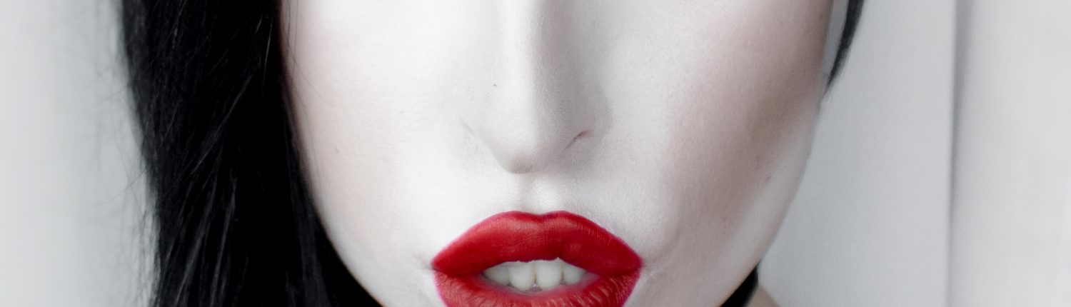 Model wearing bright red lipstick