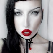 Model wearing bright red lipstick